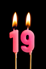 Burning candles in the form of 189 nineteen figures (numbers, dates) for cake isolated on black background. The concept of celebrating a birthday, anniversary, important date, holiday, table setting
