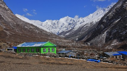High mountains Gangchenpo and others seen from Mundu, Langtang valley.