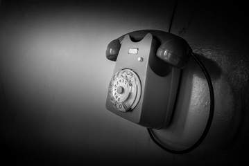 phone on wall - black and white image