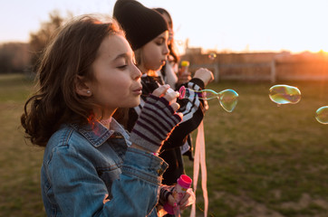 Kids playing with soap bubbles