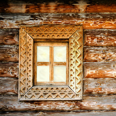 Old square wooden window. Detail of facade vintage rustic house. Can used as background.
