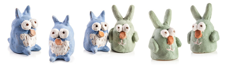Rabbits and owls figurines from clay made by children