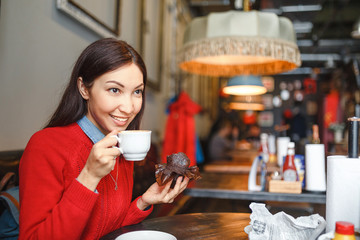 woman drinking coffee or tea in the morning at restaurant