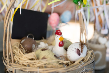 decorative chicken in a basket with eggs