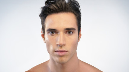 Close up of a man's face after hydrating his skin and protects against impurities with anti-aging effects. Concept of: beauty and body care, creams, skincare