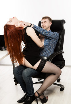 boss is sexually harassing to her sexy secretary. Office abuse and harassment concept