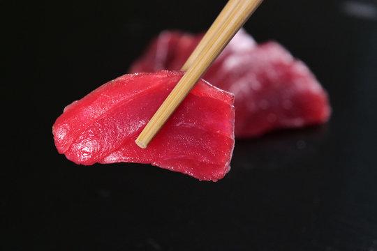 Macro shot of sushi, sashimi, uramaki and nighiri. typical Japanese dish consisting of rice, salmon or tuna,shrimp and fish eggs soaked in soy. Concept: Japanese restaurant, sushi,