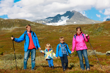 family with two kids hiking in mountains, nature travel