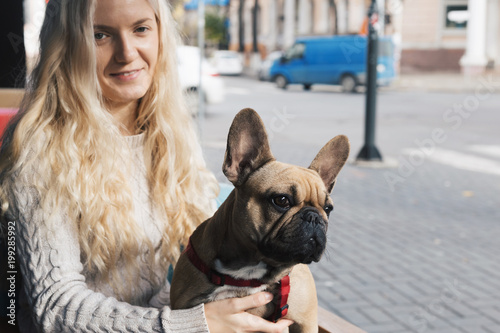 eadff00bb5fe French bulldog relaxing in a cafe on blonde stylish woman's lap ...