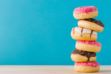 Stack of sweet donuts Wall mural