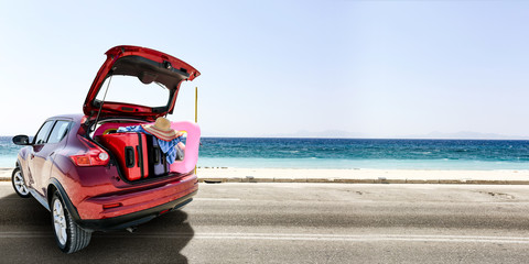 summer car on road and sea landscape
