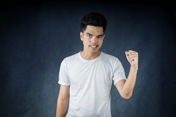 Portrait handsome young asian man wearing a white shirt excitement or celebrating his victory sign isolated on white background. Asian man people. business success concept.
