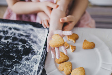 Heart-shaped cookies on the girl's hand