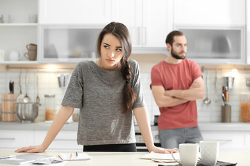 Young couple ignoring each other after having argument in kitchen Wall mural