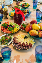 Festive table with vegetables, fruit and snacks