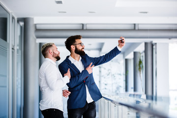 Young Business Colleagues Taking Selfie At Workplace