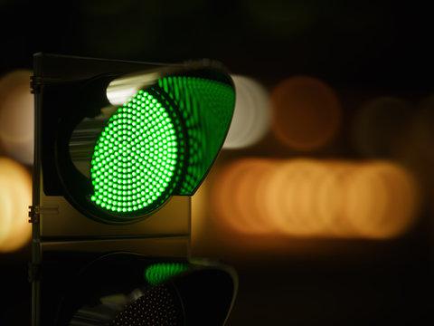 Red traffic light in the dark night city street