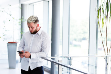 Young Stylish Businessman Using Smartphone At Break