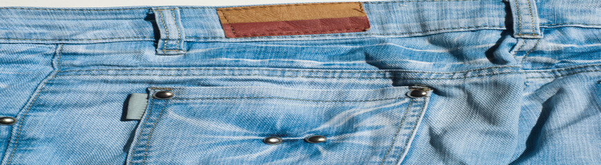 texture of denim products. background. Indigo color with bright buttons