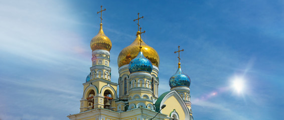 the domes of the Orthodox Church, amid blue skies, gleaming Golden domes.