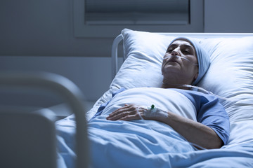 Woman alone in hospital bed