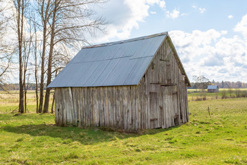 Old wooden shed in a field