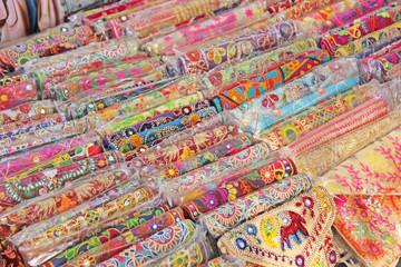 Bright national colored handbags are handmade embroidery cosmetic products sold on the market in India. Gift souvenir India Tibet Bazaar