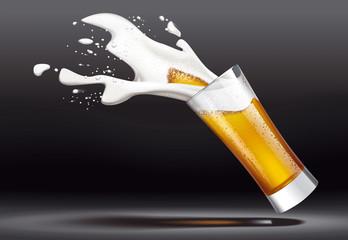 Beer and splashes foam on dark background