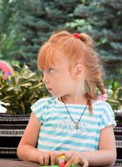 Portrait of a beautiful redheaded little girl