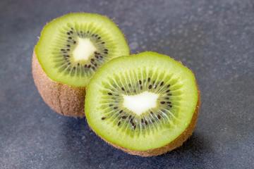 Ripe whole kiwi fruit and half kiwi fruit isolated on vintage background