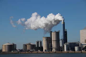 Steam coming out of the chimney at power plant in Rotterdam Maasvlakte in Netherlands