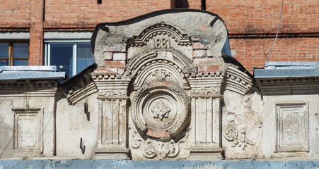 Fragment of the facade of an old house. The picture was taken in Russia, in the city of Orenburg. 04/03/2018