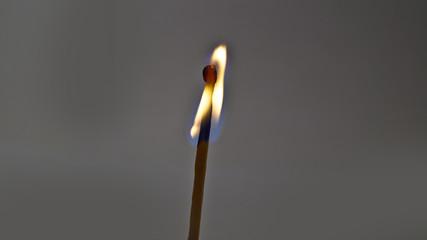 Burning wooden match