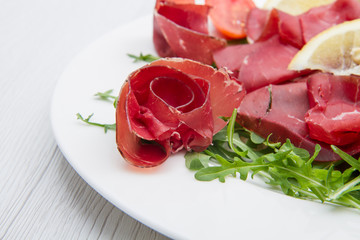 dish of bresaola and aragula