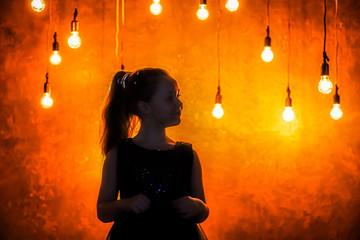 Girl is with light bulbs