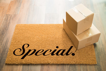 Special Welcome Mat On Wood Floor With Shipment of Boxes