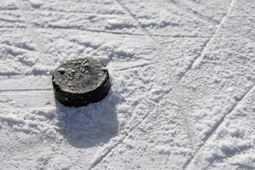 hockey puck lies on the ice in the stadium