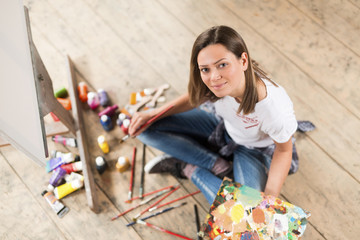 Portrait of young beautiful painter woman