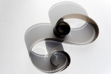 photographic film on a white sheet with a shadow in the form of a sign of unrestrictedness