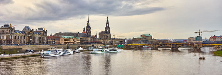 Scenic autumn view of the old town architecture with Elbe river embankment in Dresden, Saxony, Germany