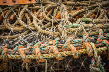 Colourful rope fishing net basket at Lyme Regis in England