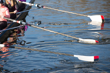 Ladies 8 rowing team with blades dipping into river Avon