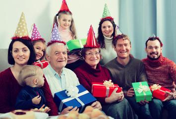 Friendly family making numerous photos