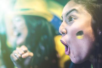 Brazilian fan celebrating during soccer match