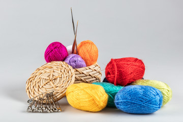 Hobby concept. Clews of colored wool yarn in basket