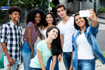 Group of international young adult people taking selfie