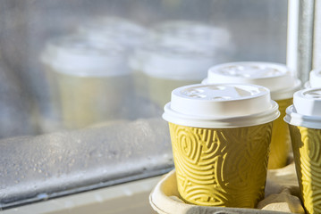 Cups of coffee on the windowsill