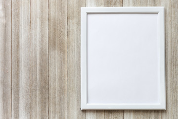 Mockup with white frame on a rustic wooden background with copy space