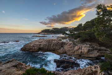 Scenic view of rocky coastline at sunset Wall mural