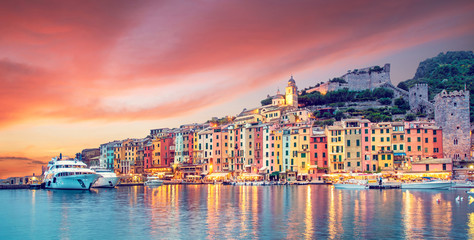 Printed roller blinds Liguria Mystic landscape of the harbor with colorful houses in the boats in Porto Venero, Italy, Liguria in the evening in the light of lanterns at sunset
